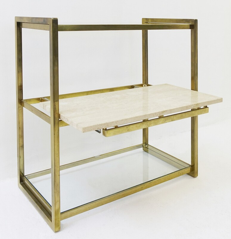 brass and glass shelving with sliding travertine shelf