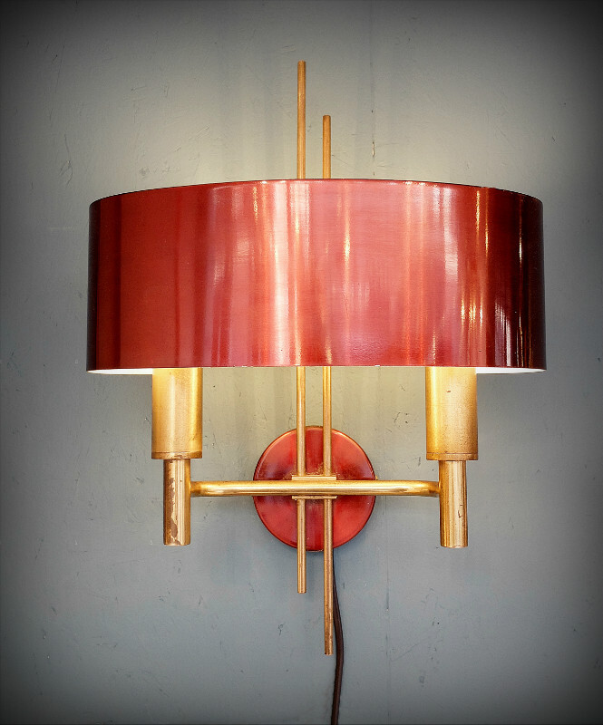 Pair of brass and metal wall lamps