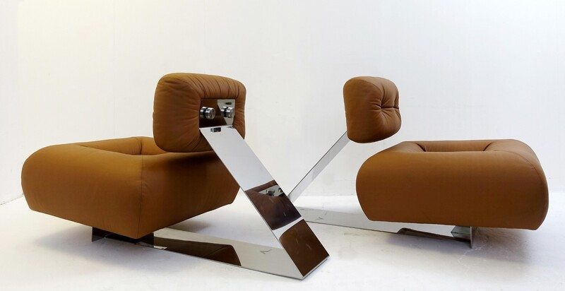 Pair of OSCAR NIEMEYER Rare 'Aran' lounge chairs, c. 1975 Leather, stainless steel