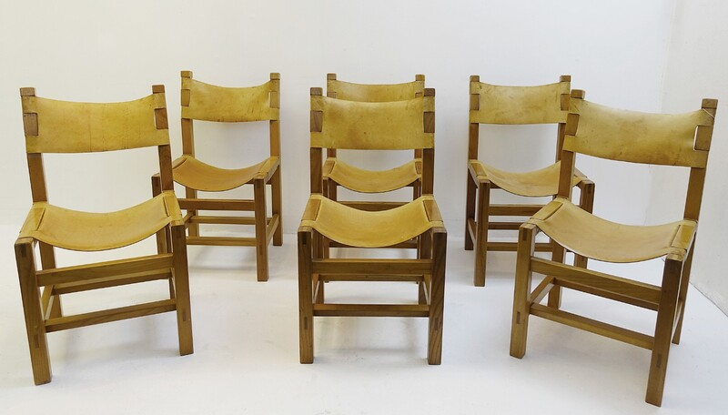 set of six elm chairs with natural leather seats by Maison Regain in the 1960s.