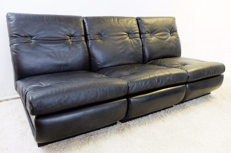 Set of three black leather lounge chairs