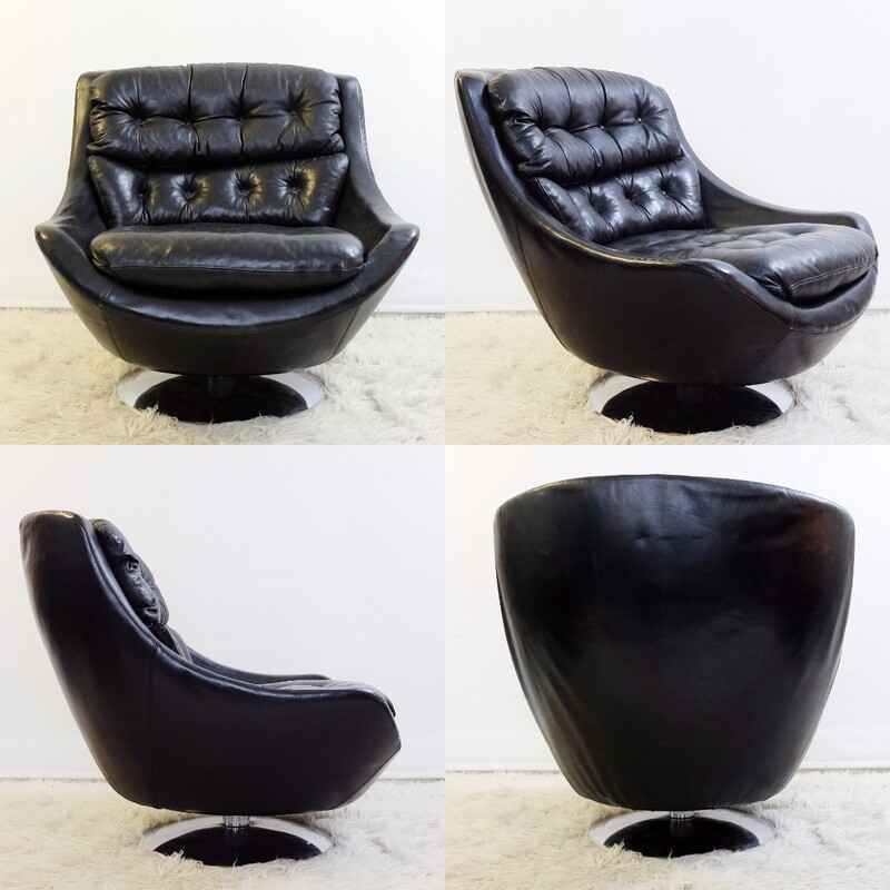 Swivel armchair in black leather