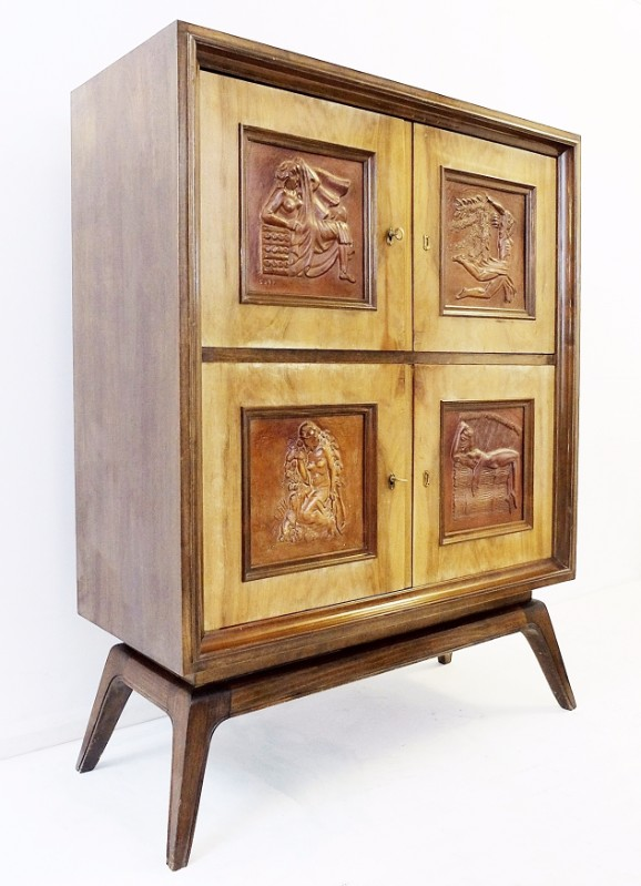 Wood cabinet with carved decorative panels circa s